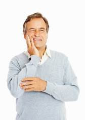 stock-photo-14533603-senior-adult-suffering-from-a-toothache-against-white