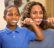 stock-photo-45285796-mother-teaches-son-how-to-properly-brush-his-teeth-bathroom